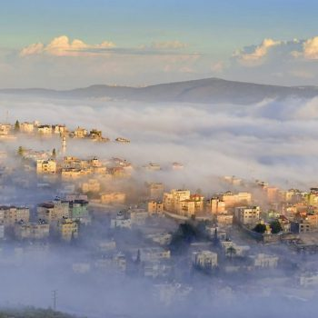 view of the shrouded in the morning fog biblical village Cana of Galilee